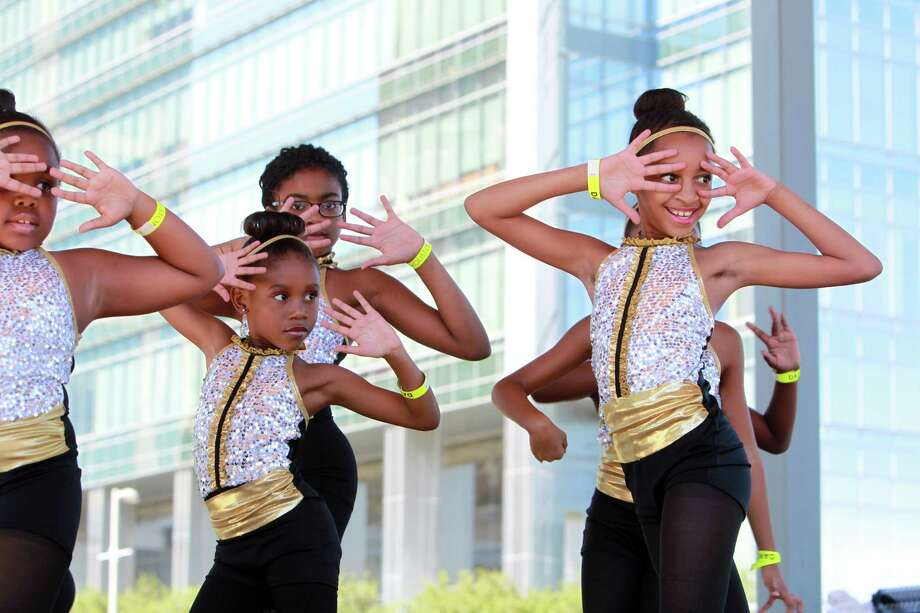 Andance Jr. Company members Clarke Fisher, Aleigha Branch, and Chianne Rice perform during the Discover Dance event at Discovery Green on Sunday, Oct. 6, 2013, in Houston. Dancers from across the Houston area gather to present various dance styles such as African, ballroom, belly dance, bollywood, Chinese, ecstatic, folk, hip hop, house, Jamaican Dance Hall, lindy hop, salsa, square, tango and swingout two-step, hosted by Dance Houston and Discovery Green. Photo: Mayra Beltran, Houston Chronicle / © 2013 Houston Chronicle