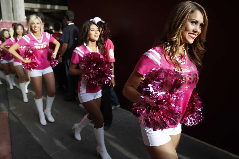 San Francisco 49ers Gold Rush cheerleaders take the field wearing pink for breast cancer awareness. Photo: Brett Coomer, Houston Chronicle