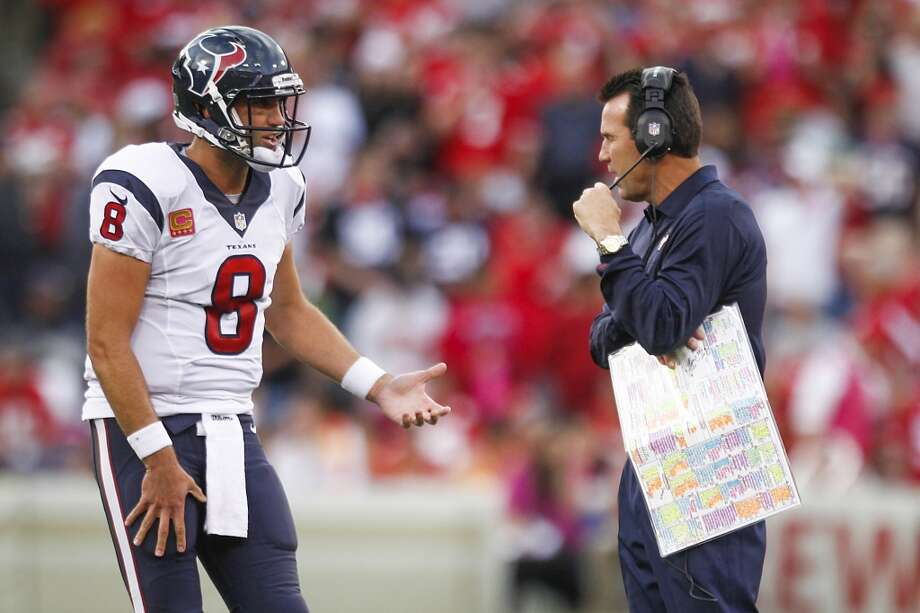 Texans quarterback Matt Schaub talks with head coach Gary Kubiak during the second quarter. Photo: Brett Coomer, Houston Chronicle
