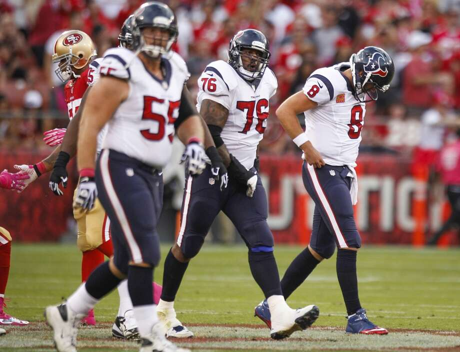 Texans quarterback Matt Schaub (8), tackle Duane Brown (76) and center Chris Myers (55) head toward the bench. Photo: Brett Coomer, Houston Chronicle