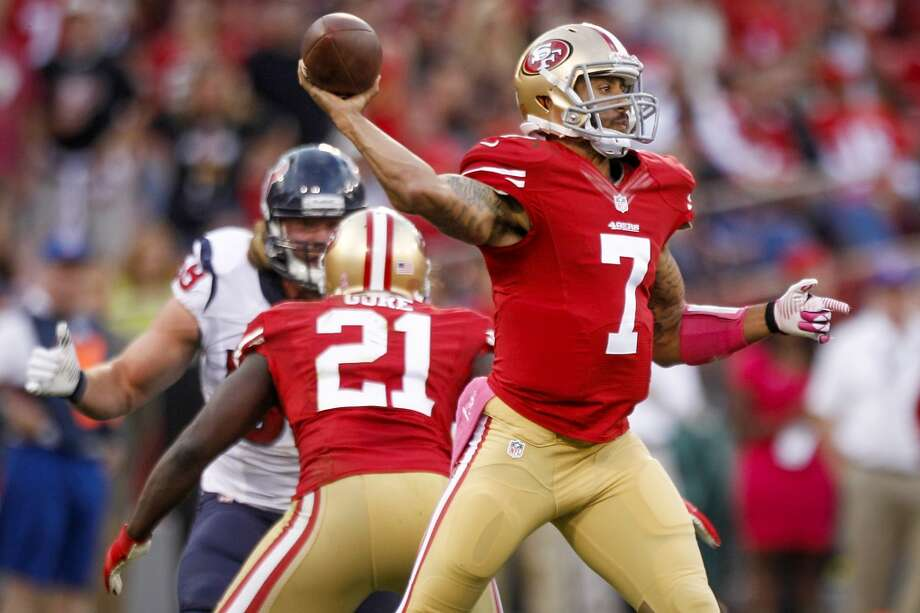 49ers quarterback Colin Kaepernick throws a pass during the second quarter. Photo: Brett Coomer, Houston Chronicle