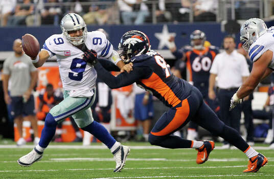 Dallas Cowboys' quarterback Tony Romo is sacked by Denver Broncos' Shaun Phillips in the first half at the AT&T Stadium in Arlington, Texas, Sunday, Oct. 6, 2013. Photo: Jerry Lara, San Antonio Express-News / ©2013 San Antonio Express-News