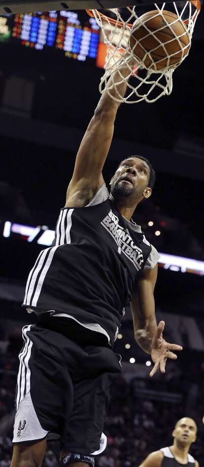 Spurs' Tim Duncan dunks during an open scrimmage held Sunday Oct. 6 2013 at the AT&T Center. Photo: San Antonio Express-News