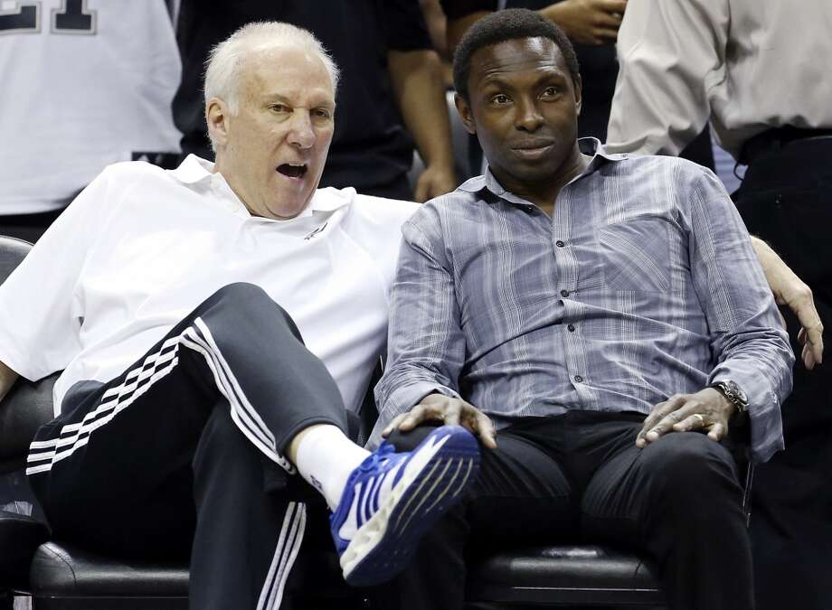 Spurs head coach Gregg Popovich (left) talks with former Spurs player Avery Johnson during an open scrimmage held Sunday Oct. 6 2013 at the AT&T Center. Photo: San Antonio Express-News