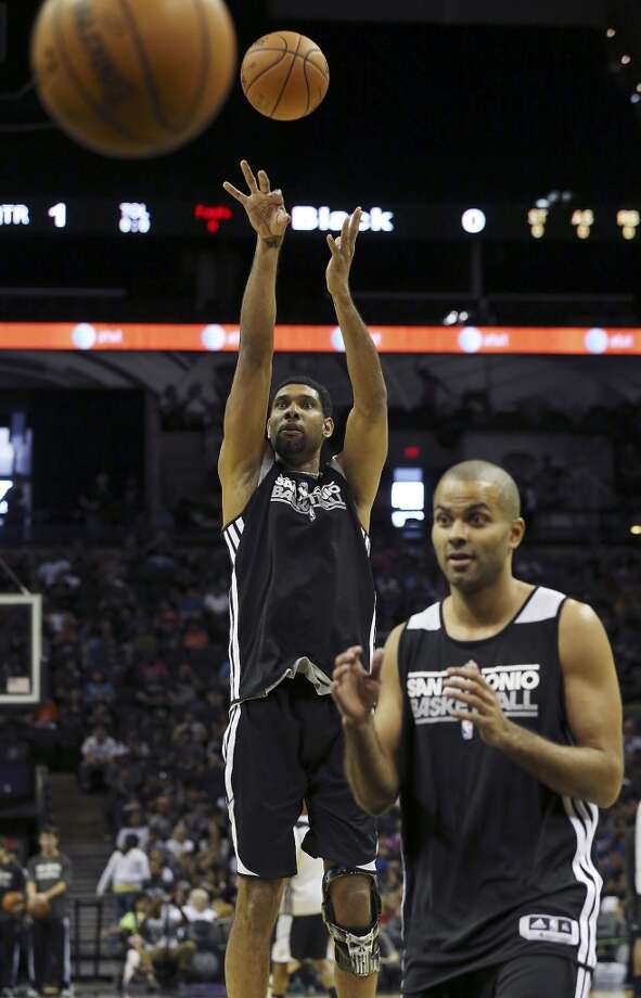 Spurs' Tim Duncan shoots over teammate Tony Parker before an open scrimmage held Sunday Oct. 6 2013 at the AT&T Center. Photo: San Antonio Express-News