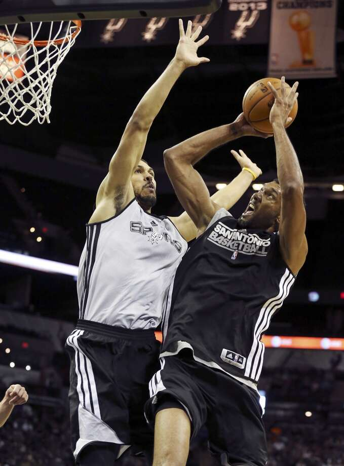 Spurs' Jeff Ayres defends Spurs' Tim Duncan during an open scrimmage held Sunday Oct. 6 2013 at the AT&T Center. Photo: San Antonio Express-News