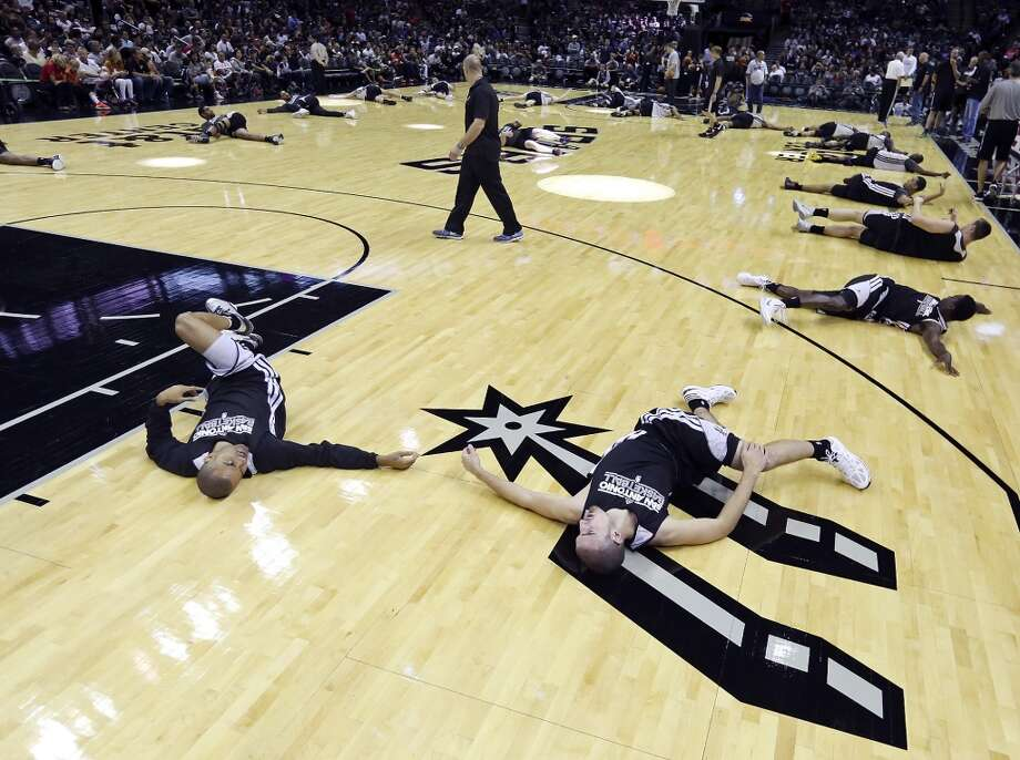 Spurs' Tony Parker (left) talks with teammate Nando De Colo before an open scrimmage held Sunday Oct. 6 2013 at the AT&T Center. Photo: San Antonio Express-News