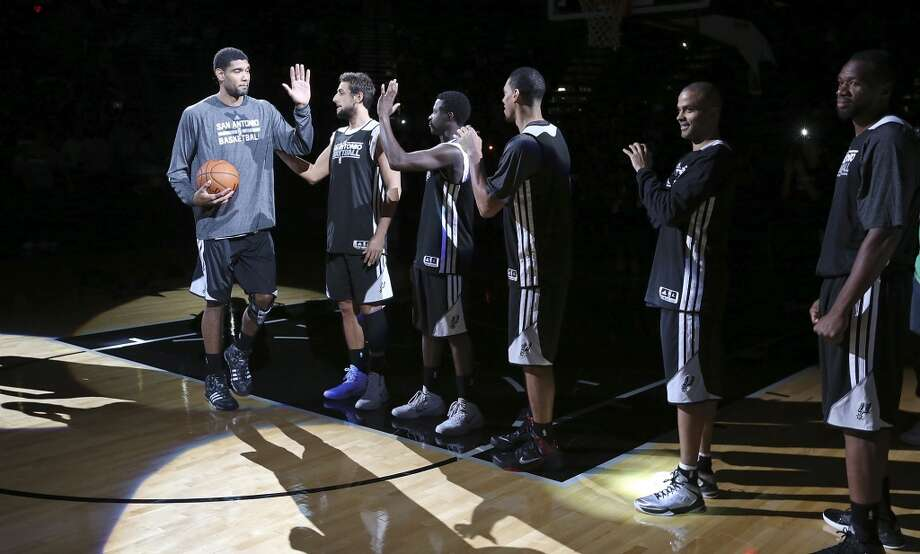 Spurs' Tim Duncan (left) is introduced before an open scrimmage held Sunday Oct. 6 2013 at the AT&T Center. Photo: San Antonio Express-News