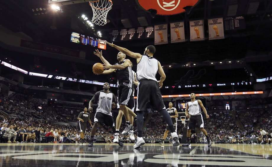 Spurs' Tony Parker drives to the basket during an open scrimmage held Sunday Oct. 6 2013 at the AT&T Center. Photo: San Antonio Express-News