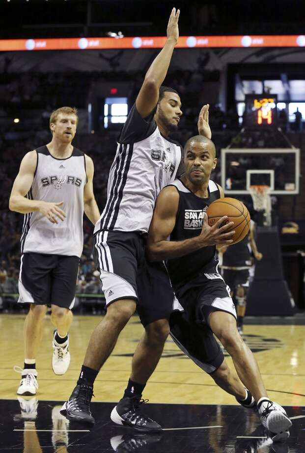 Spurs' Tony Parker drives to the basket against Spurs' Cory Joseph during an open scrimmage held Sunday Oct. 6 2013 at the AT&T Center. Photo: San Antonio Express-News