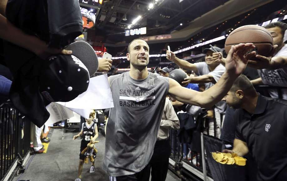 Spurs' Manu Ginobili leaves the court after an open scrimmage held Sunday Oct. 6 2013 at the AT&T Center. Photo: San Antonio Express-News