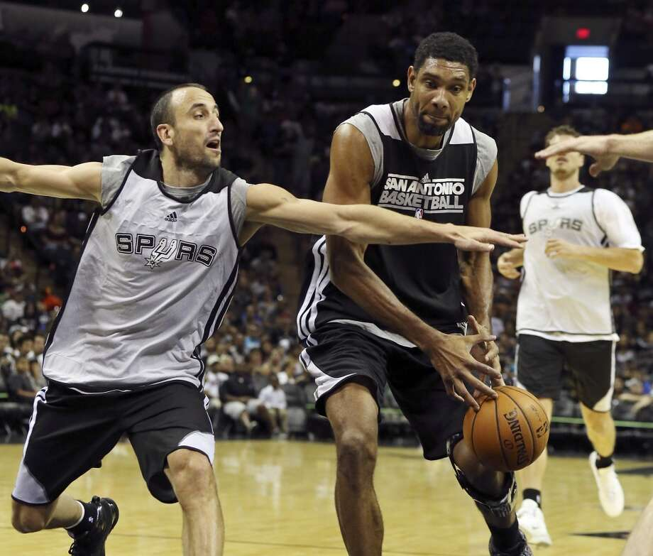 Spurs' Manu Ginobili defends Spurs' Tim Duncan during an open scrimmage held Sunday Oct. 6 2013 at the AT&T Center. Photo: San Antonio Express-News