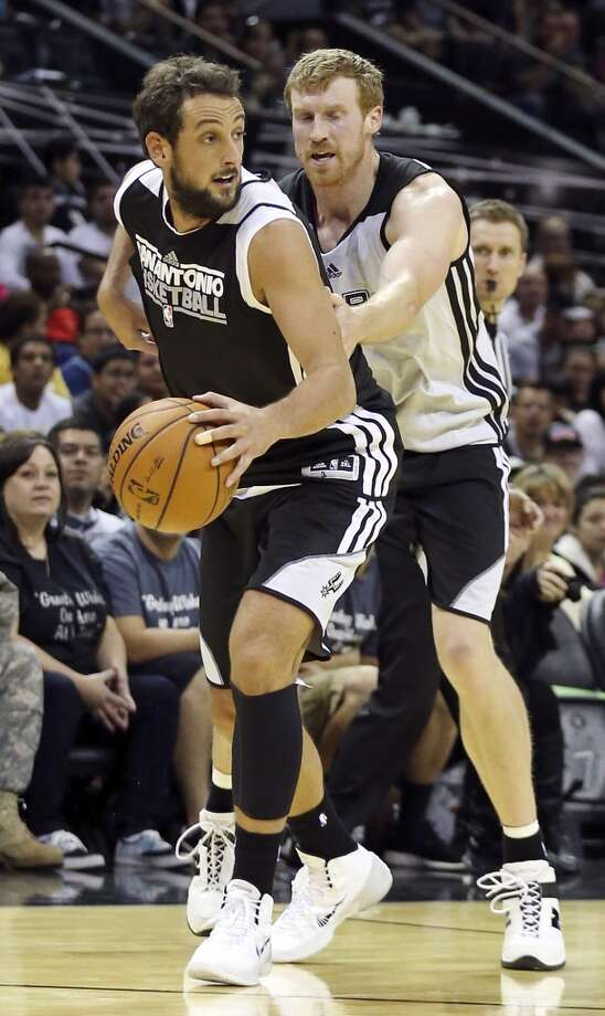 Spurs' Marco Belinelli looks for room around Spurs' Matt Bonner during an open scrimmage held Sunday Oct. 6 2013 at the AT&T Center. Photo: San Antonio Express-News