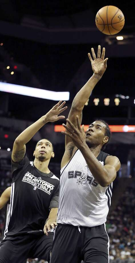 Spurs' Kawhi Leonard shoots around Spurs' Danny Green during an open scrimmage held Sunday Oct. 6 2013 at the AT&T Center. Photo: San Antonio Express-News