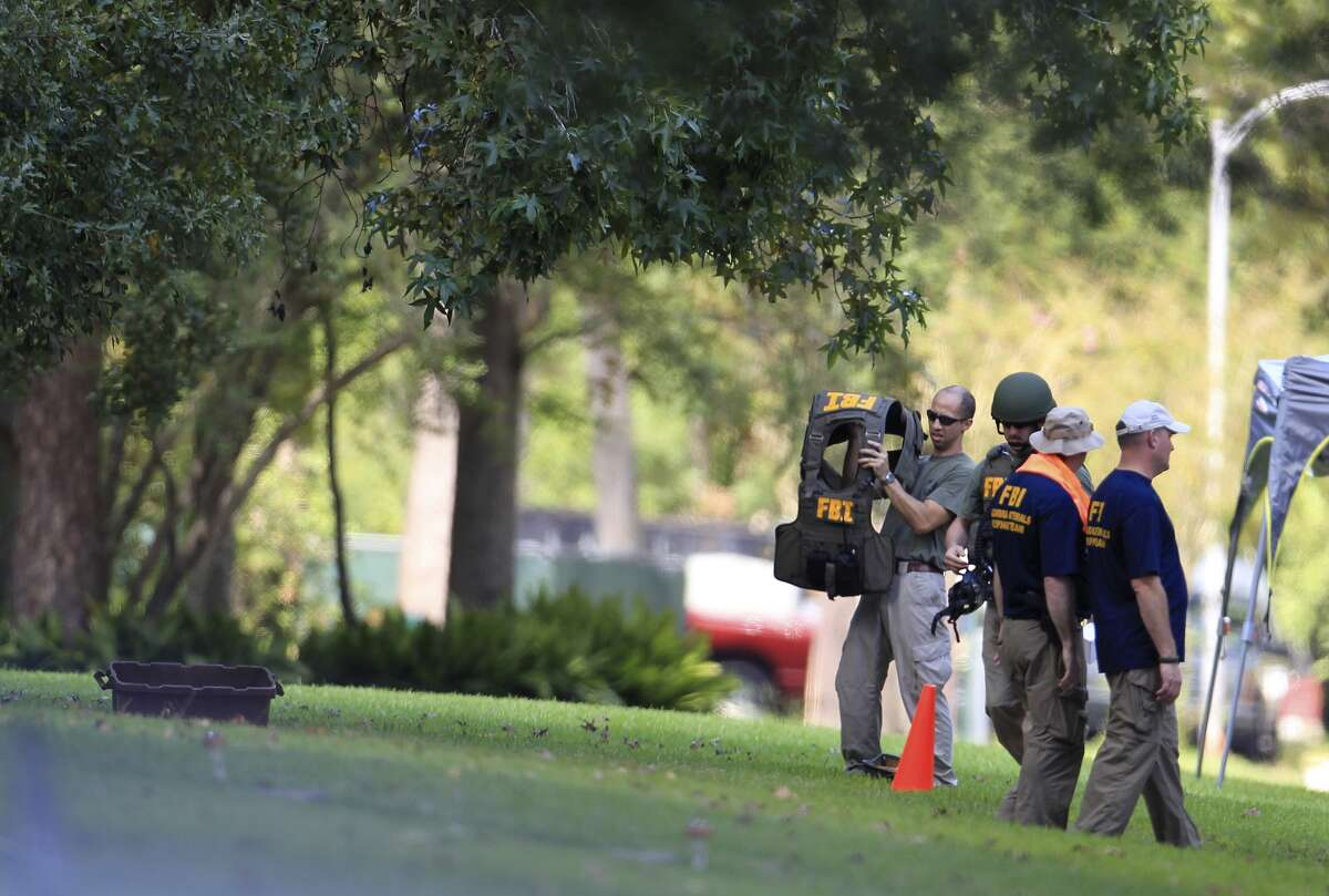 Members of the FBI prepare to detonate an unknown substance at a home at 411 Fall River Road in the Memorial area, Saturday, Oct. 5, 2013, in Houston.