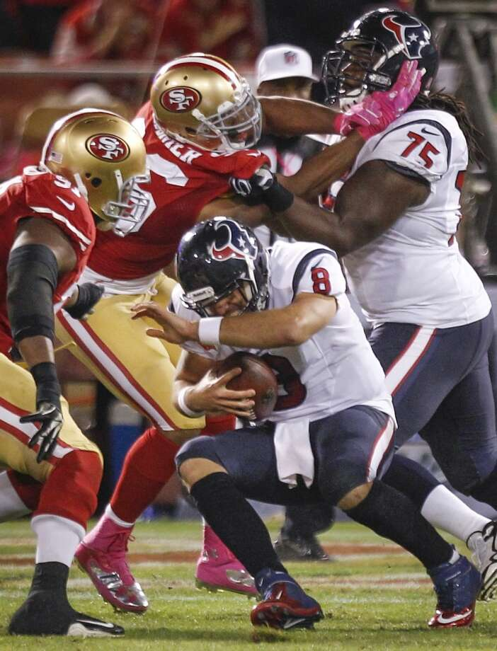 Texans quarterback Matt Schaub goes down during the third quarter. Photo: Brett Coomer, Houston Chronicle
