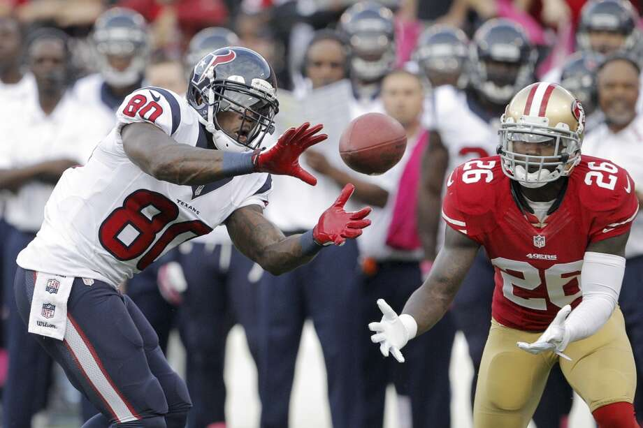 Texans wide receiver Andre Johnson has a pass go through his hands to be intercepted by 49ers defensive back Tramaine Brock. Photo: Carlos Avila Gonzalez, San Francisco Chronicle