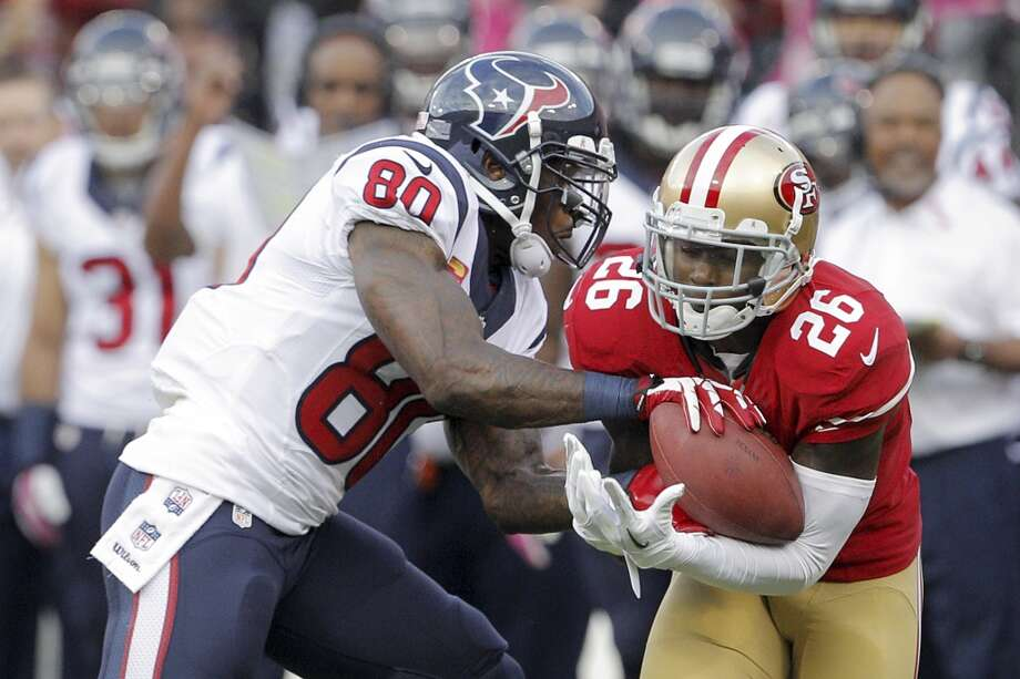49ers defensive back Tramaine Brock  intercepts a pass intended for Texans wide receiver Andre Johnson. Photo: Carlos Avila Gonzalez, San Francisco Chronicle