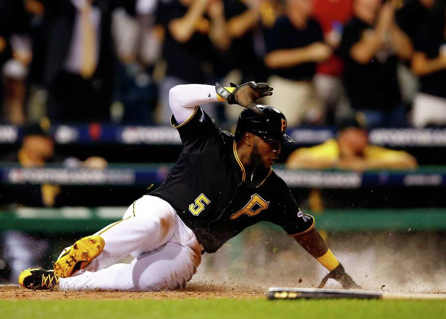 Pinch runner Josh Harrison brings home the go-ahead run in the eighth inning. Photo: Justin K. Aller, Stringer / 2013 Getty Images