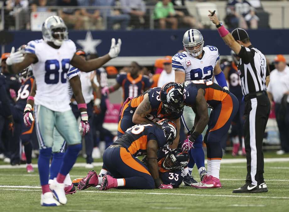 Dallas Cowboys' wide receiver Dez Bryant, (88), reacts after fumbling the ball and recovered by Denver Broncos' Duke Ihenacho, (33), in the first half at the AT&T Stadium in Arlington, Texas, Sunday, Oct. 6, 2013. Photo: San Antonio Express-News