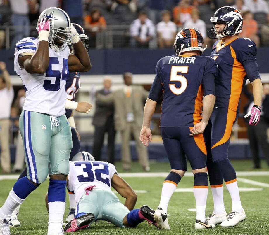 Denver Broncos' punter Britton Colquitt, right, celebrates a last second field goal by kicker Matt Prater as Dallas Cowboys' linebacker Bruce Carter reacts as the game ends at the AT&T Stadium in Arlington, Texas, Sunday, Oct. 6, 2013. The Broncos won, 51-48. Photo: San Antonio Express-News