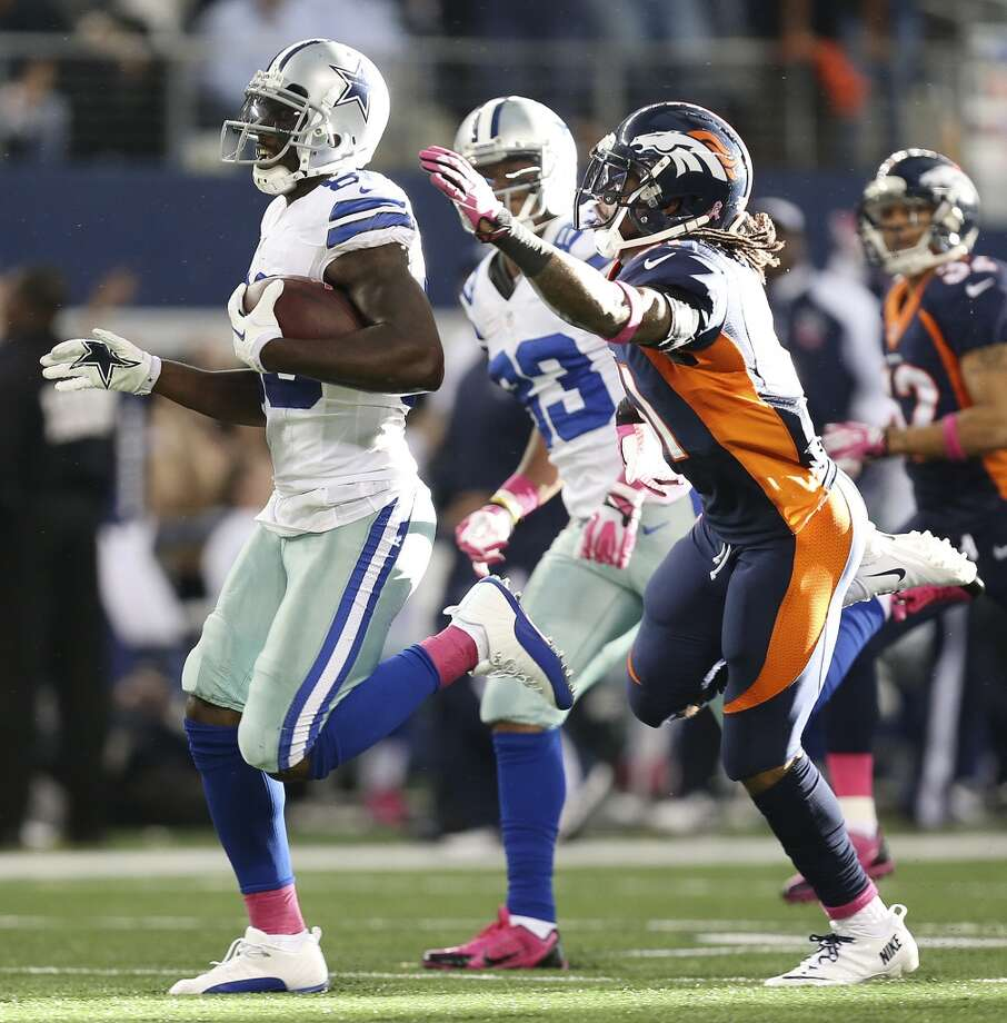 Dallas Cowboys' wide receiver Dez Bryant carries the ball for an 80-yard reception as Denver Broncos' Omar Bolden gives chase in the second half at the AT&T Stadium in Arlington, Texas, Sunday, Oct. 6, 2013. The Broncos won, 51-48. Photo: San Antonio Express-News