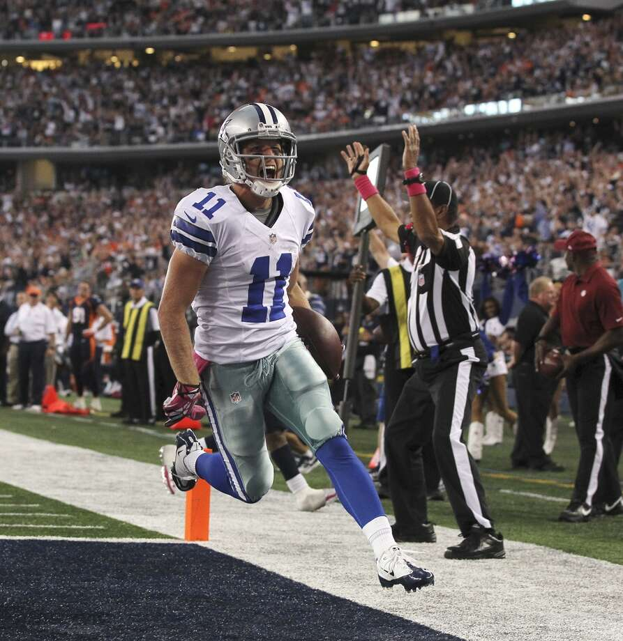 Dallas Cowboys' wide receiver Cole Beasley celebrates a third quarter touchdown against the Denver Broncos at the AT&T Stadium in Arlington, Texas, Sunday, Oct. 6, 2013. The Broncos won, 51-48. Photo: San Antonio Express-News