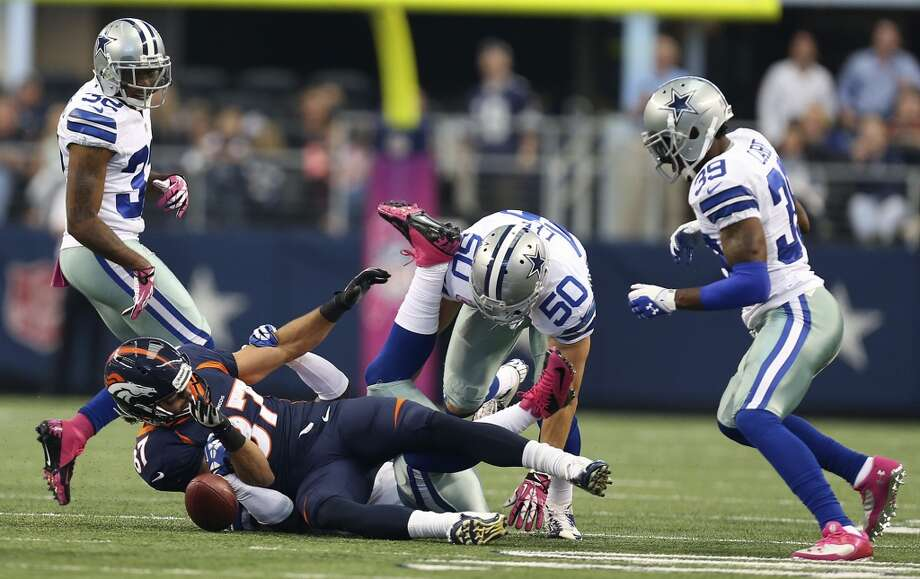 Denver Broncos' wide receiver Eric Decker fumbles the ball and is recovered by the Dallas Cowboys in the first half at the AT&T Stadium in Arlington, Texas, Sunday, Oct. 6, 2013. Surrounding Decker are from left, Orlando Scandrick, Sean Lee and Brandon Carr. Photo: San Antonio Express-News