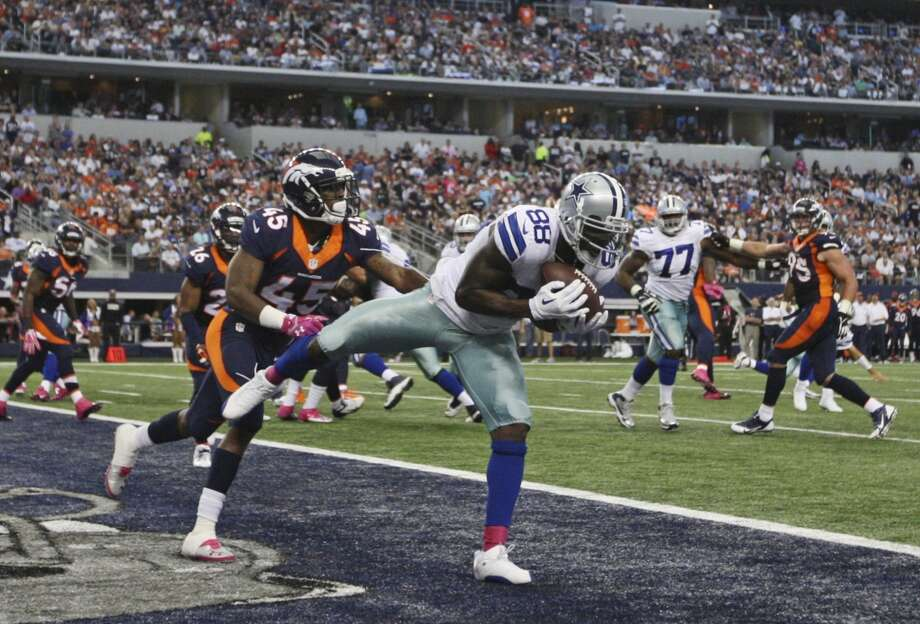 Dallas Cowboys' Dez Bryant pulls in a Tony Romo pass for a touchdown as Denver Broncos' D. Rodgers-Cromartie defense in the second half at the AT&T Stadium in Arlington, Texas, Sunday, Oct. 6, 2013. The Broncos won, 51-48. Photo: San Antonio Express-News
