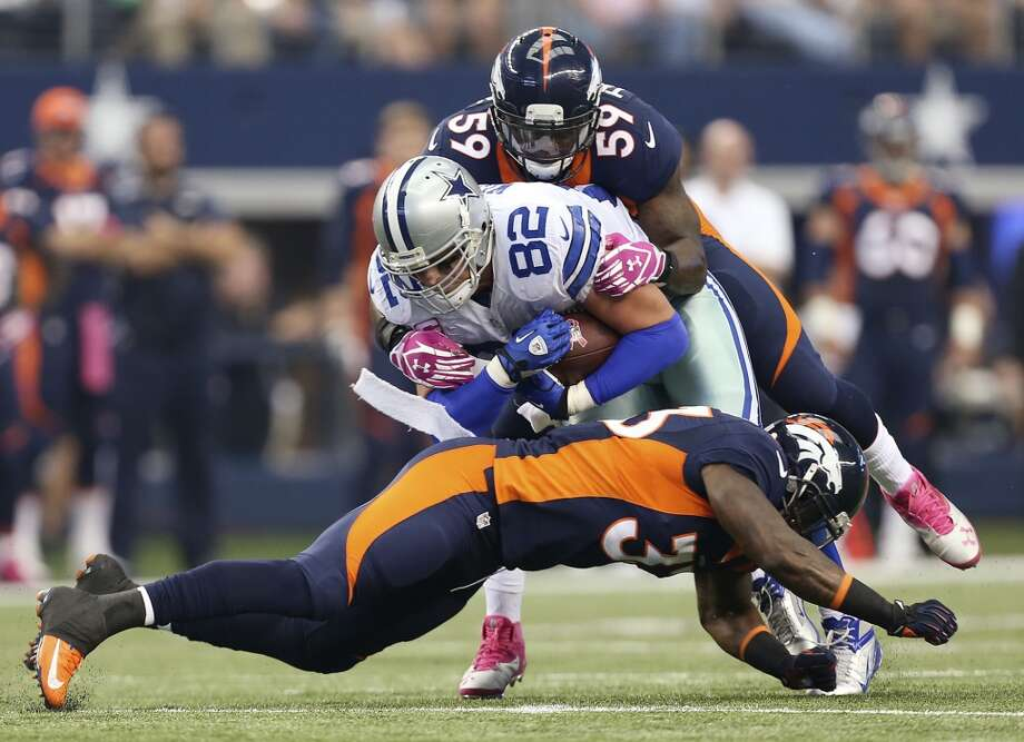 Dallas Cowboys' Jason Witten is tacked by Denver Broncos' Danny Trevathan, (59), and Duke Ihenacho in the first half at the AT&T Stadium in Arlington, Texas, Sunday, Oct. 6, 2013. The Broncos won, 51-48. Photo: San Antonio Express-News