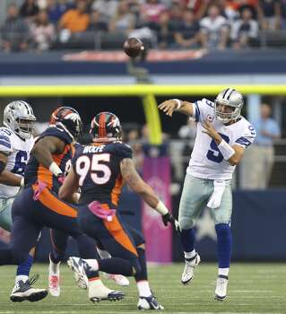 Dallas Cowboys' Tony Romo unloads the ball under pressure from the Denver Broncos' defense in the first half at the AT&T Stadium in Arlington, Texas, Sunday, Oct. 6, 2013. The Broncos won, 51-48. Photo: San Antonio Express-News