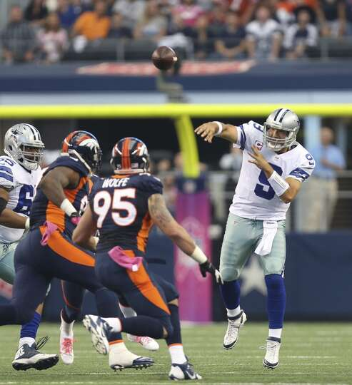 Dallas Cowboys' Tony Romo unloads the ball under pressure from the Denver Broncos' defense in the