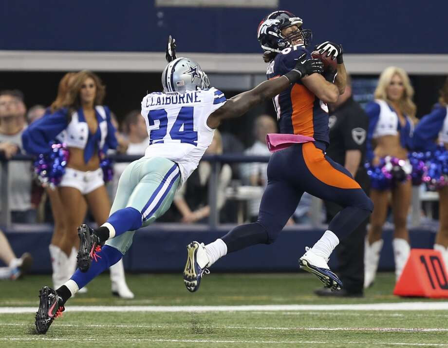 Denver Broncos' wide receiver Eric Decker catches a pass from Peyton Manning as Dallas Cowboys' cornerback Morris Claiborne defense in the first half at the AT&T Stadium in Arlington, Texas, Sunday, Oct. 6, 2013. The Broncos won, 51-48. Photo: San Antonio Express-News