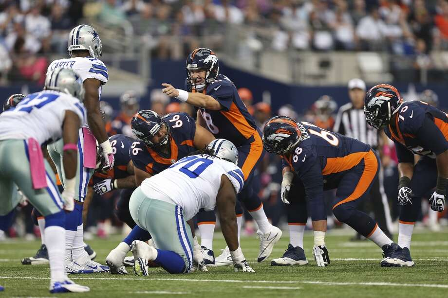 Denver Broncos' quarterback Payton Manning calls an audible in the first half against the Dallas Cowboys at the AT&T Stadium in Arlington, Texas, Sunday, Oct. 6, 2013. The Broncos won, 51-48. Photo: San Antonio Express-News