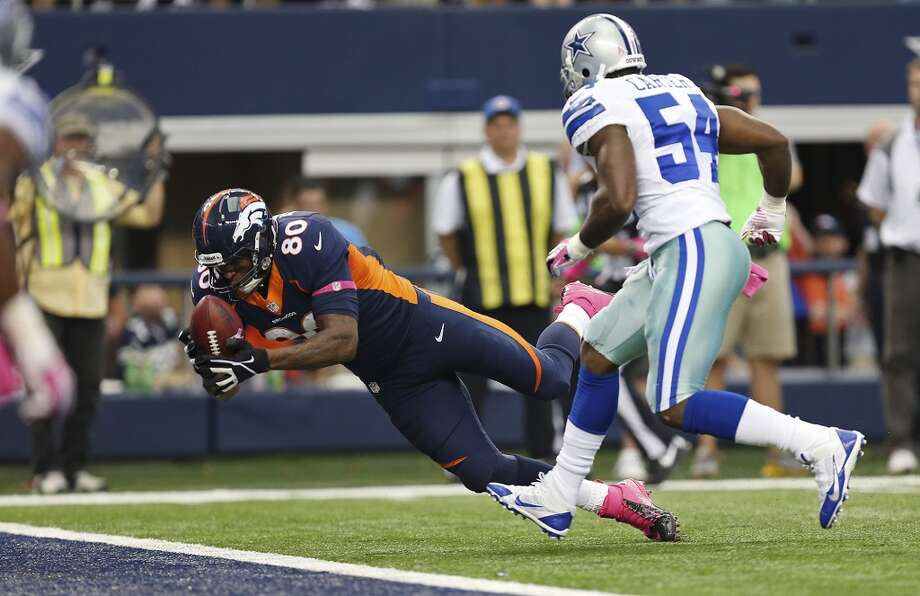 Denver Broncos' tightend Julius Thomas stretches for a touchdown as Dallas Cowboys' linebacker Bruce Carter arrives too late in the first half at the AT&T Stadium in Arlington, Texas, Sunday, Oct. 6, 2013. The Broncos won, 51-48. Photo: San Antonio Express-News