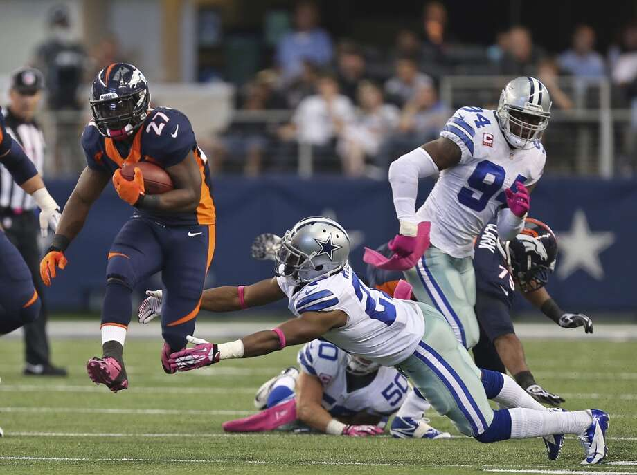 Denver Broncos' Knowshon Moreno runs by Dallas Cowboys J.J. Wilcox in the first half at the AT&T Stadium in Arlington, Texas, Sunday, Oct. 6, 2013. The Broncos won, 51-48. Photo: San Antonio Express-News