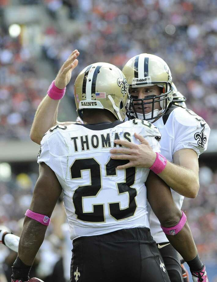 Drew Brees (right) embraces Pierre Thomas as the Saints beat the Bears in Chicago for the first time since a 31-10 victory on Oct. 8, 2000. Photo: David Banks / Getty Images