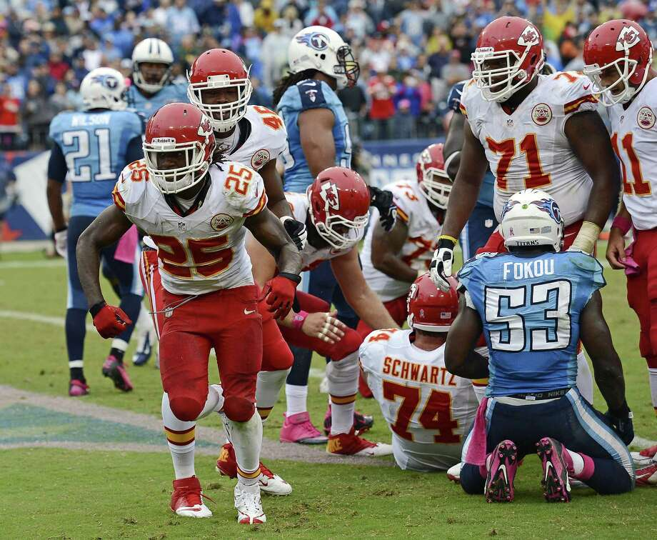 Jamaal Charles' 1-yard touchdown run in the fourth propelled the Chiefs to their first 5-0 start since 2003. Charles, a Texas-ex, rushed for 108 yards. Photo: Mark Zaleski / Associated Press