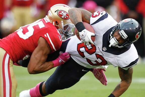 Houston Texans running back Arian Foster (23) is brought down by San Francisco 49ers free safety Eric Reid (35) during the first quarter of an NFL football game at Candlestick Park Sunday, Oct. 6, 2013, in San Francisco. ( Brett Coomer / Houston Chronicle )
