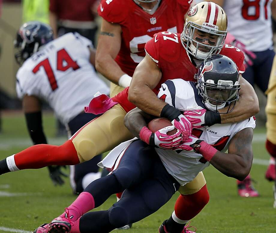 The Texans Ben Tate (44) was hauled down by the 49ers Michael Wilhoite (57) in the first half Sunday october 6, 2013 in San Francisco, Calif. The San Francisco 49ers defeated the Houston Texans 34-3 at Candlestick Park. Photo: Brant Ward, The Chronicle
