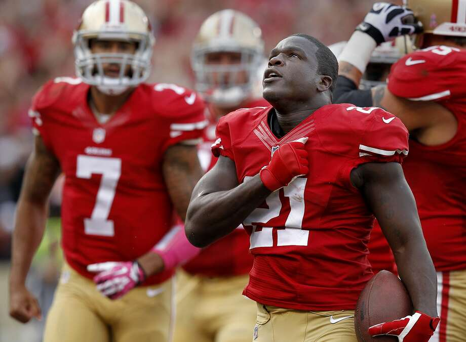 Frank Gore pounded his chest after his first half touchdown Sunday October 6, 2013 in San Francisco, Calif. The San Francisco 49ers vs the Houston Texans at Candlestick Park. Photo: Brant Ward, The Chronicle