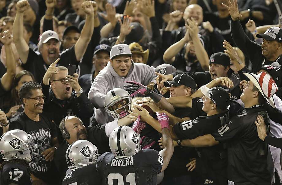 Oakland Raiders wide receiver Rod Streater, bottom center, celebrates with fans and teammates after catching a touchdown pass during the first quarter of an NFL football game against the San Diego Chargers in Oakland, Calif., Sunday, Oct. 6, 2013. (AP Photo/Ben Margot) Photo: Ben Margot, Associated Press