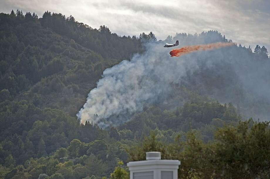 A fire burned on a steep, wooded hillside on October 6, 2013 in Larkspur, Calif. Photo: Monte Deignan