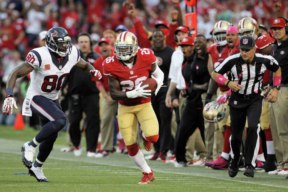 The 49ers' Tramaine Brock, right, steps in front of Andre Johnson to become the latest player to return an errant Matt Schaub pass for a touchdown. Photo: Carlos Avila Gonzalez, Staff Photographer / ONLINE_YES