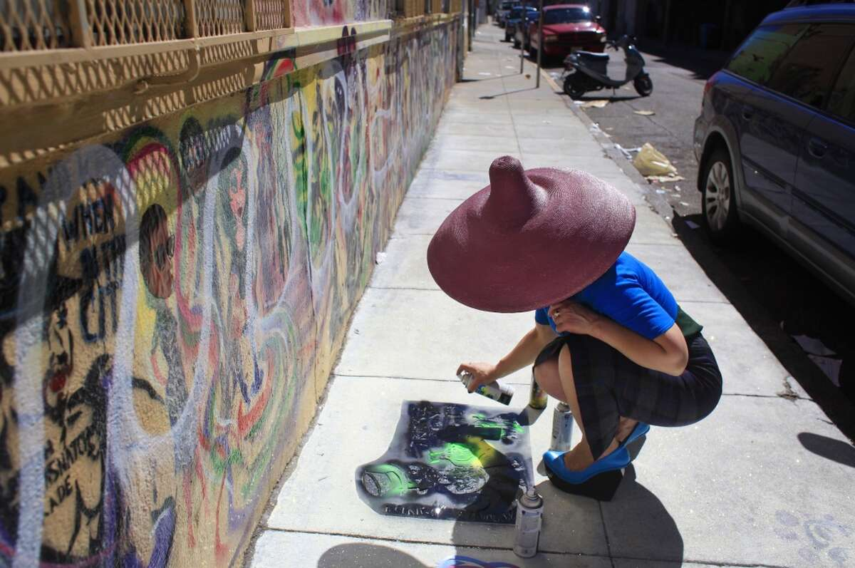 Street artist Eclair Bandersnatch works on the Grace Alley Mural Project in San Francisco, Calif.