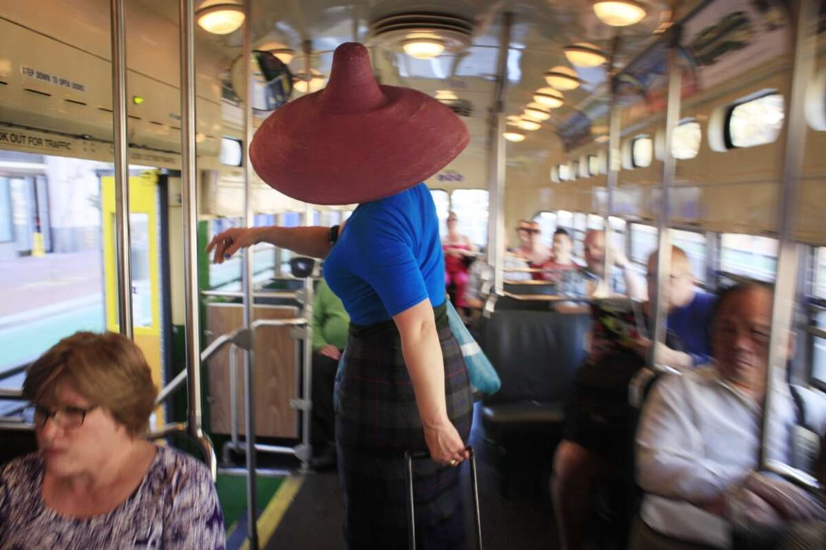 Street artist Eclair Bandersnatch moves about the city on public transportation in San Francisco, Calif.