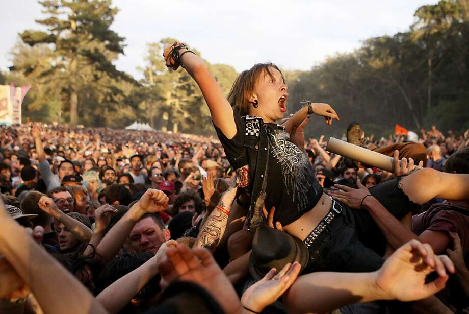 A Gogol Bordello fan crowd surfs at the Hardly Strictly Bluegrass Festival in Golden Gate Park, in San Francisco, Ca, on Sunday, Oct. 6, 2013. Photo: Raphael Kluzniok, The Chronicle
