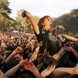 A Gogol Bordello fan crowd surfs at the Hardly Strictly Bluegrass Festival in Golden Gate Park, in San Francisco, Ca, on Sunday, Oct. 6, 2013.