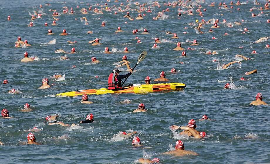 Hey! That's cheating!Some 2,000 swimmers and one kayaker make their way across Victoria Harbor during the 1.5k 