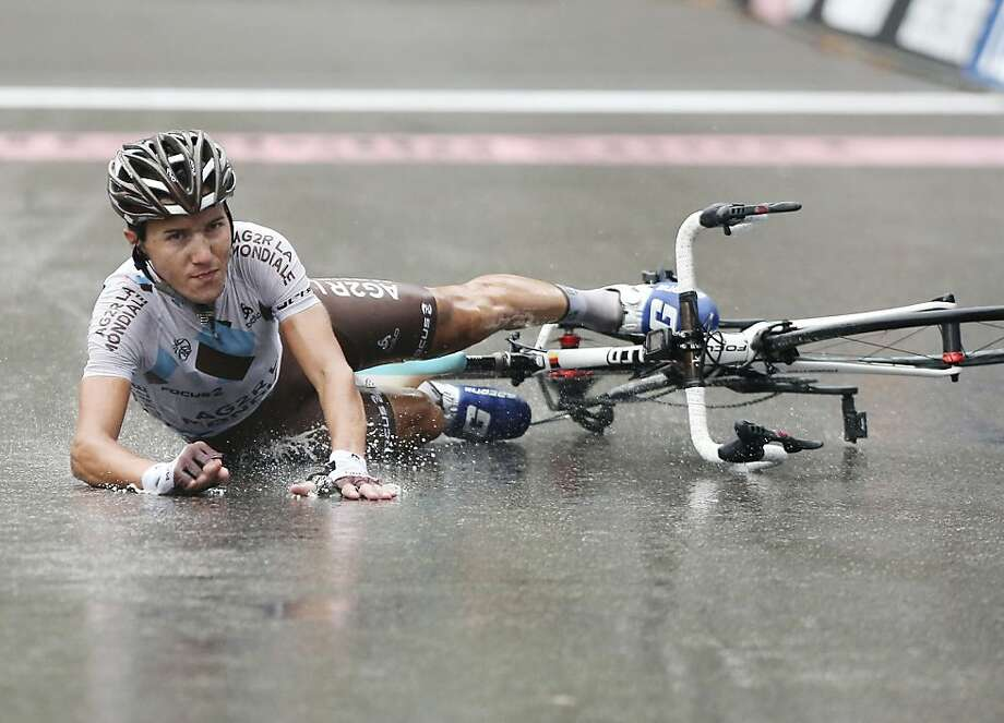 Slippery when wet: Looking more annoyed than hurt, Domenico Pozzovivo of Italy slides across the finish line after spilling his bike at the Tour of Lombardy in Lecco, Italy. Photo: Antonio Calanni, Associated Press